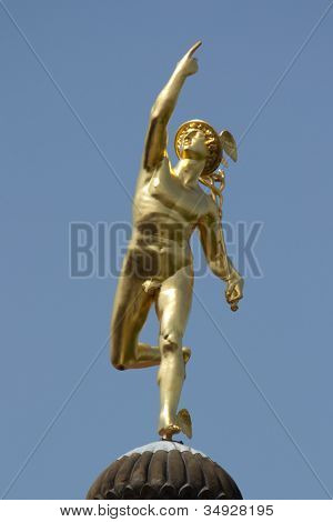STUTTGART, GERMANY - JUNE 30: The Roman God Mercury statue made by the German sculptor Johann Ludwig von Hofer in 1862, on top of the Old Chancellery Building on June 30, 2012 in Stuttgart, Germany.
