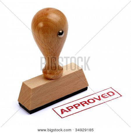 Rubber stamper with the word APPROVED printed in red