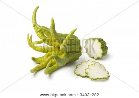 Buddha's hand fruit with slices on white background