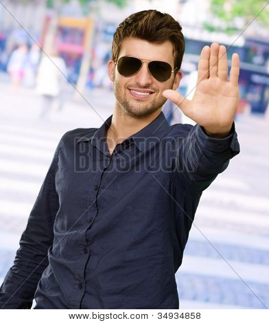 Portrait Of Young Man Doing Stop Signal, Outdoor