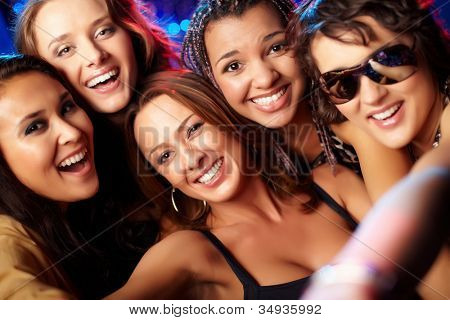 Close-up shot of group of laughing girls having party