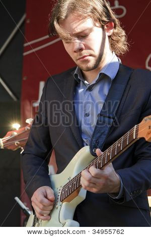 Martijn Smit Dressed In A Suit Plays Guitar Live On Stage