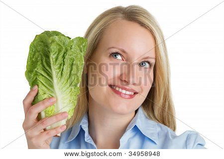 Attractive Smiling Woman Holding Fresh Lettuce