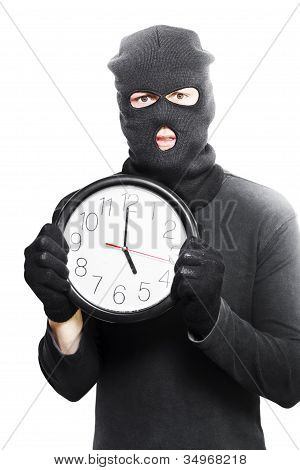 Male Criminal In Mask Holding A Clock