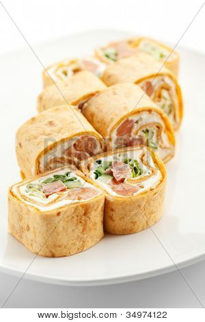 Mexico Maki Sushi - Roll made of Smoked Salmon, Cream Cheese, Cucumber and Spring Onion inside. Tortilla outside