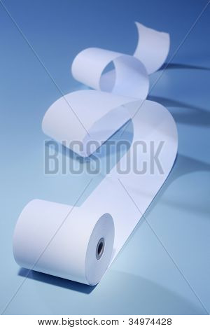 Roll of paper curling on the blue background