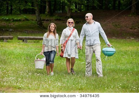 Full length portrait of group of friends out for a bbq picnic