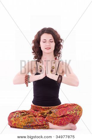 Portrait of hippie young woman doing yoga exercise