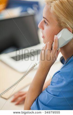 Nurse calling in hospital reception