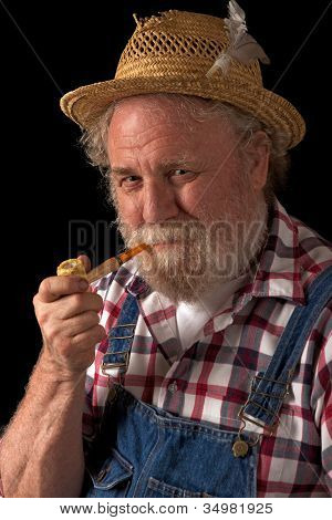 Traditional Farmer With Straw Hat And Corncob Pipe