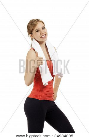 happy young fitness woman with a white towel showing thumb up