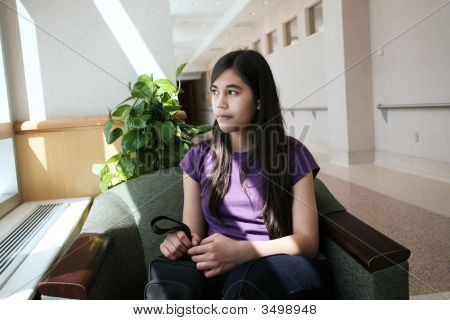 Young Teen Girl In Waiting Room
