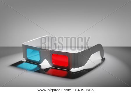 Disposable cardboard 3D Anaglyph glasses with cyan/red lenses.