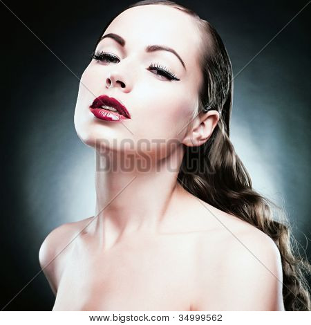 Close-up portrait of sexy caucasian young woman with beautiful eyes and sensual lips