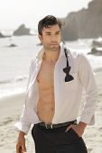 stock photo of enticing  - Great looking fit man in open white shirt formal wear outdoors with sexy body - JPG