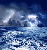stock photo of storms  - a storm with a lightning on the sea - JPG