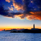 Ibiza island sunset with freus lighthouse and Es Vedra in background