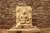 stock photo of budha  - ancient statue of Gautham Budha locates at  Sanchi Stupa in India - JPG
