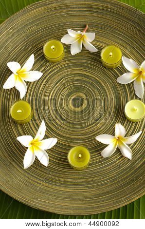 spa supplies frangipani withcandle image of tropical spa.