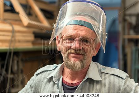 The Portrait Of Craftsman That Picked Up Face Shield.