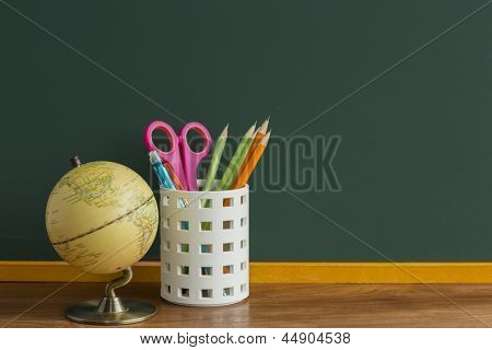 A blackboard and terrestrial globe