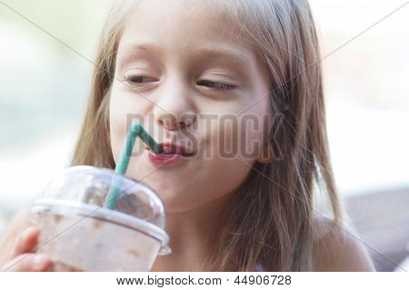 Funny Little Girl Drinks Milkshake