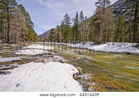 Rushing River With Winter Snowmelt