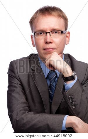 man portrait in grey suit and glasses isolated on white background