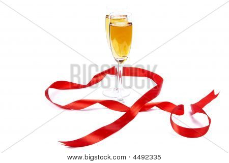 Two Wine Glasses And Red Tape