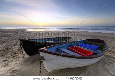 Fishing Boats On A Sandy Beach