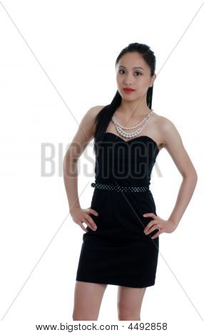 Asian Woman In A Little Black Dress Isolated