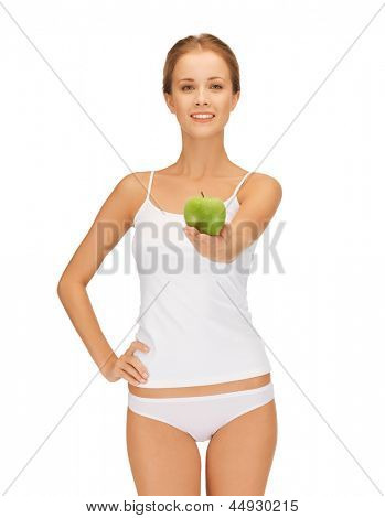 beautiful young woman in white underwear holding green apple