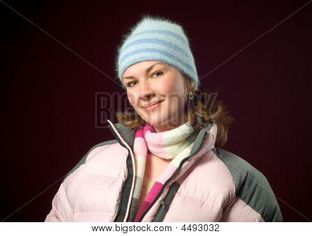Pretty Redhead Woman Model Wearing Pink Winter Down Ski Coat