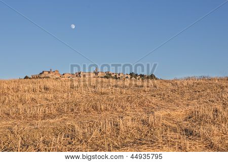 Optical Illusion Of A Village Behind The Hill