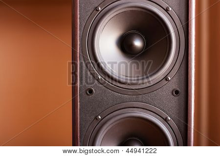 Powerful audio system. Closeup view of black bass power speaker