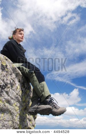 Woman Hiker Relaxes In Mountains