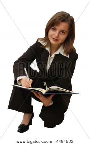 Isolated Business Woman Writing With Pen In A Notepad