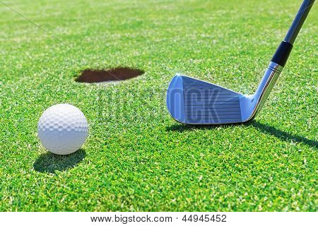 Golf Stick  Ball Near The Hole. Against The Background Of Grass.