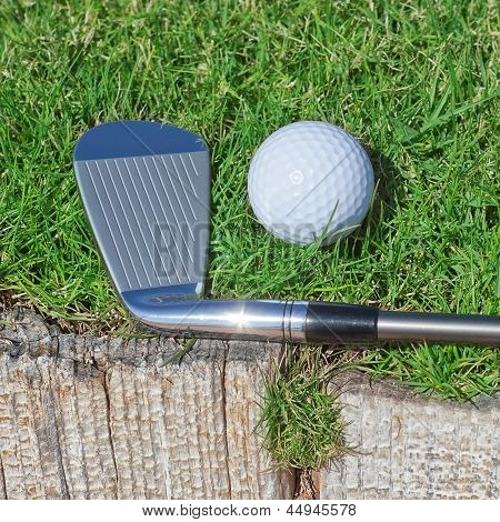 Golf Stick And Ball Support Wooden Close-up On The Grass.