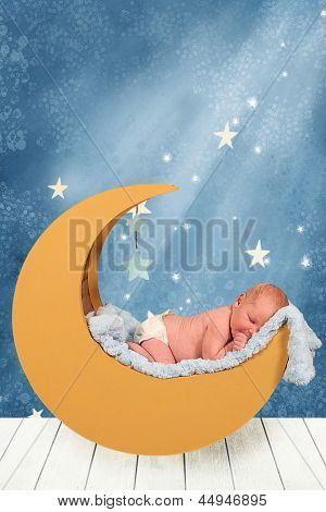 Beautiful Little Newborn baby boy in moon prop