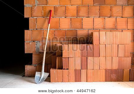 Masonry Shovel Bucket And Bricks