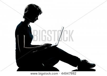 one caucasian young teenager silhouette  girl computer computing laptop full length in studio cut out isolated on white background