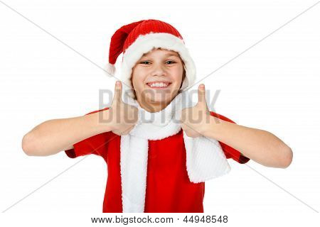 Happy Boy In Santa Claus Hat Showing Thumbs Up, On White