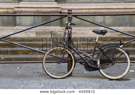 Classic Old Bicycle Against Fence