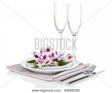 Festive table setting with flowers isolated on white