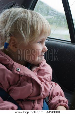Little Girl Looks In Automobile Window