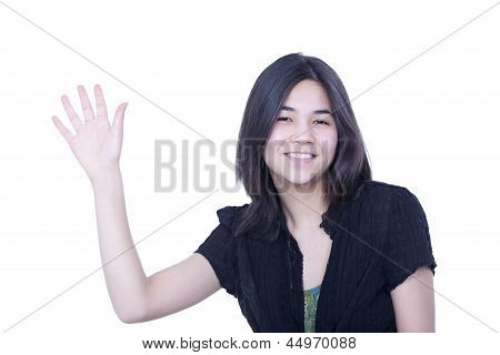 Friendly Young Teen Girl Waving Hello Or Goodbye