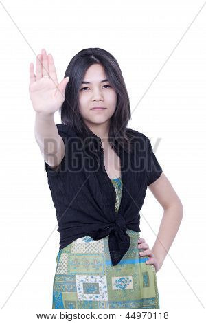 Young Biracial Teen Girl Putting Hands Up To Say 'stop', One Hand On Hip