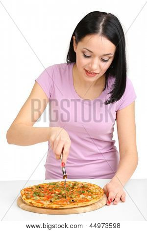 Beautiful girl cut pizza isolated on white