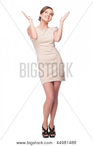 Full length portrait of happy excited woman with raised arms looking up. Over white background